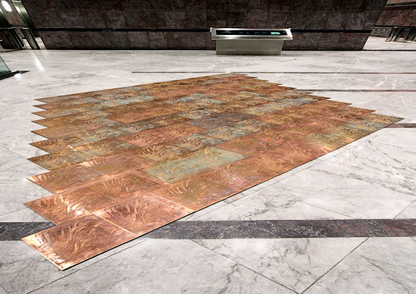 Copper floor designed by Grenville Davey, these individual panels were manufactured by the chemical etching process, by Etch Tech Ltd.