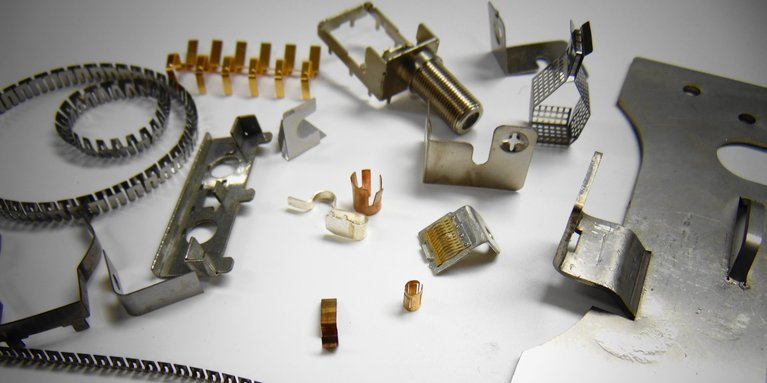 Chemically etch parts which have been formed after etching and before photofabrication