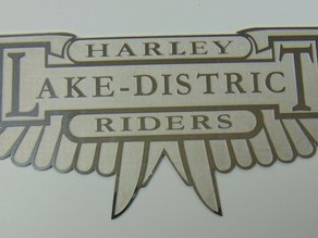 set of Harley wing chemically surface etched made for a club to give out as prizes, all manufactured through Chemical Milling.