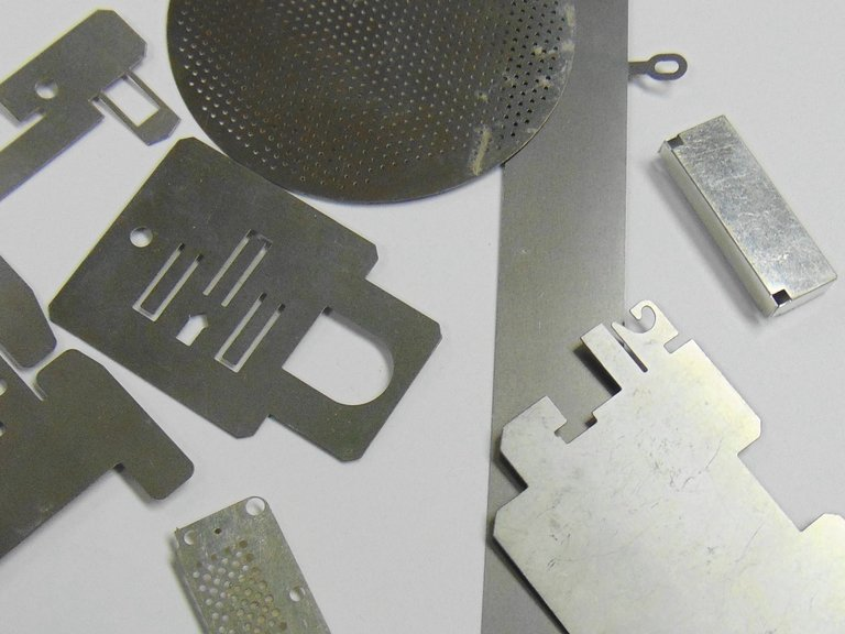 more etched Aluminium components manufactured by chemical milling.
