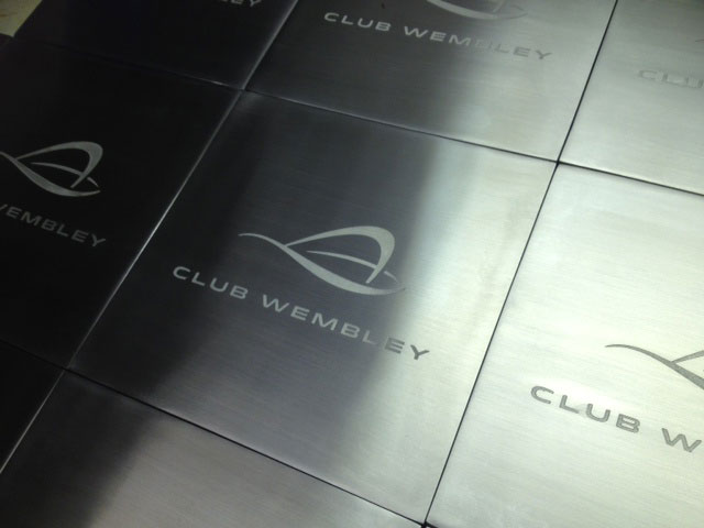 Etched metal signs for boxes at Wembley stadium manufactured using the process of chemical etching and made by Etch Tech Ltd.