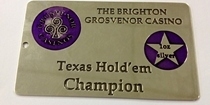 A metal card, surface etched in brass and supplied to the Grosvenor Casino. This brass card was surface etched using the photo etching / chemical milling process, and in-filled with paint.